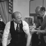 President Gerald Ford receives a swine flu inoculation from his White House physician, William Lukash, in 1976. (David Hume Kennerly/Courtesy Gerald R. Ford Library).